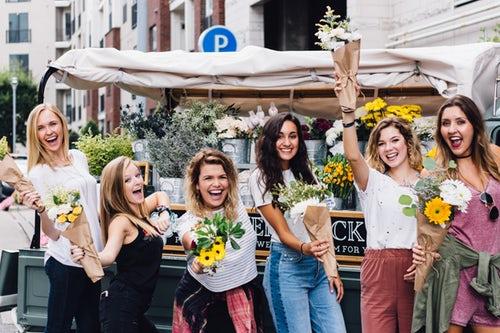 ladies having fun with flowers